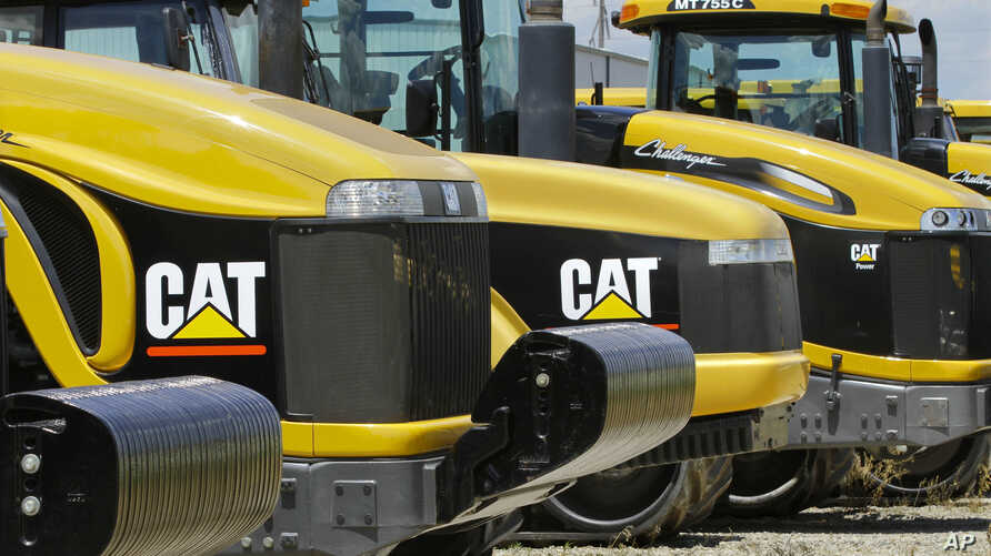 FILE - Earth-moving tractors and equipment made by Peoria, Illinois-based Caterpillar Inc. are seen in Clinton, Illinois, June 20,2012. Caterpillar's recent decision to move 300 top headquarters jobs to the Chicago area made Peoria the latest city wi