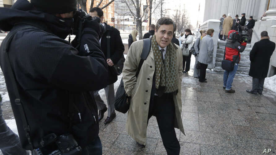 """FILE - Jonathan Turley, attorney for Kody Brown and his four wives, the stars of the reality show """"Sister Wives,"""" leaves the Frank E. Moss United States Courthouse, in Salt Lake City, Utah, Jan. 17, 2013."""