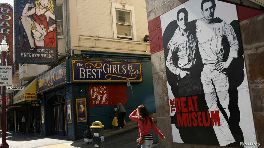 The figures of author Jack Kerouac (L) and Neal Cassady are painted on the wall of the Beat Museum in the North Beach neighborhood in San Francisco, California, May 27, 2012.