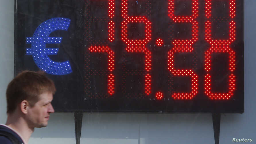 A board, showing the currency exchange rates of the euro against the Russian ruble, is on display in a street in Moscow, Russia April 10, 2018.