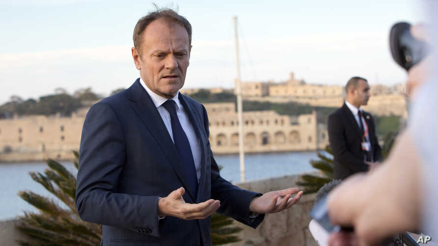 European Council President Donald Tusk speaks with the media prior to an EU summit outside his hotel in Valletta, Malta on Feb. 2, 2017.