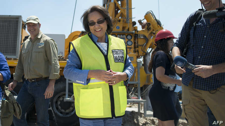 Cape Town City Mayor Patricia de Lille (C) talks to media at a site where the city council has ordered drilling into the aquifer to tap water, in Mitchells Plain, about 25km from the city center on Jan. 11, 2018 in Cape Town.