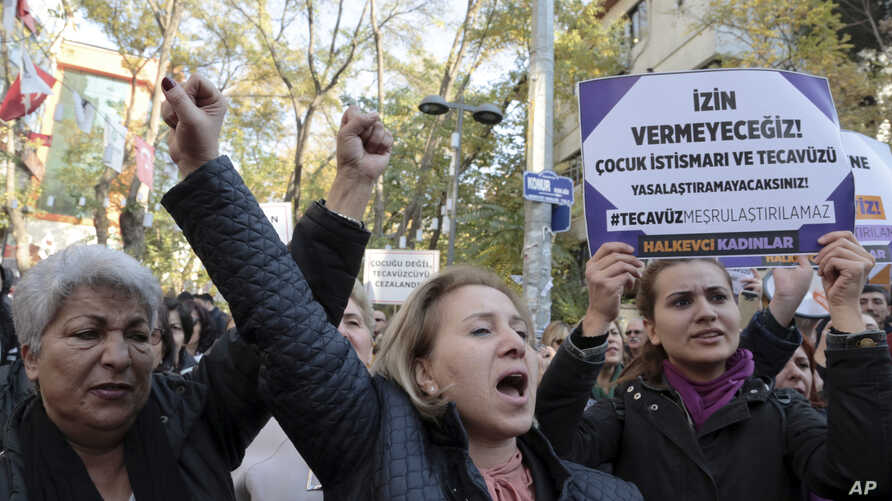 Turkish women stage a protest in Ankara, Turkey, Nov. 19, 2016, after a debate flared in Turkey after a government proposal which would pardon some people imprisoned for statutory rape, fell short of passage by legislators.