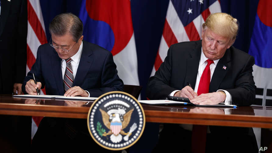 President Donald Trump, right, and South Korean President Moon Jae-In participate in a signing ceremony for the United States-Korea Free Trade Agreement at the Lotte New York Palace hotel during the U.N. General Assembly,  Sept. 24, 2018.