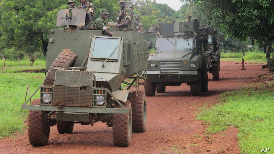 FILE - Ugandan troops patrol Zemio, in Central African Republic, where they are hunting down the fugitive members of the Lord's Resistance Army rebel group.