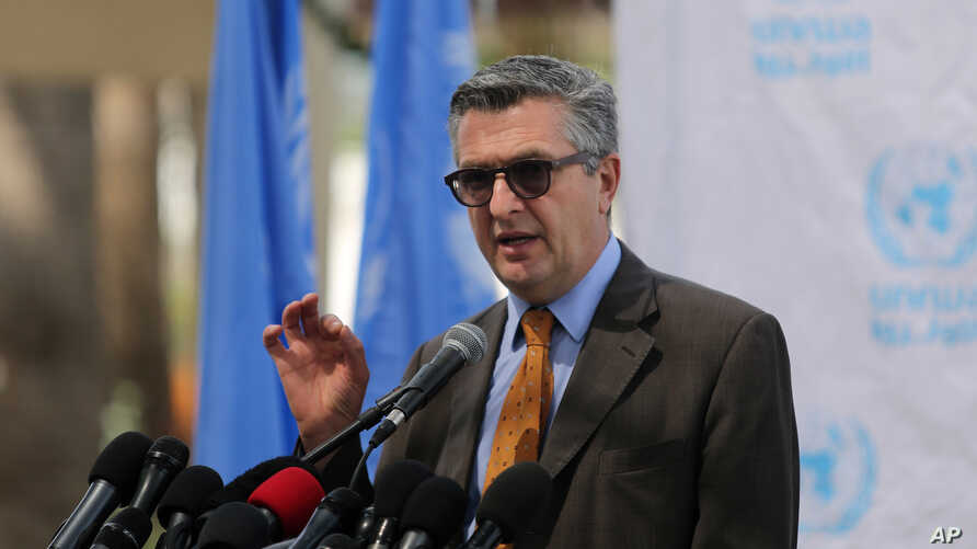 FILE - Filippo Grandi, at the time UNRWA Commissioner-General, is seen speaking during a press conference in Gaza City, March 25, 2014.