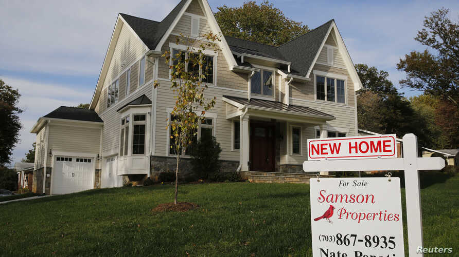 FILE - A real estate sign advertising a new home for sale is pictured in Vienna, Virginia, outside of Washington, Oct. 20, 2014.