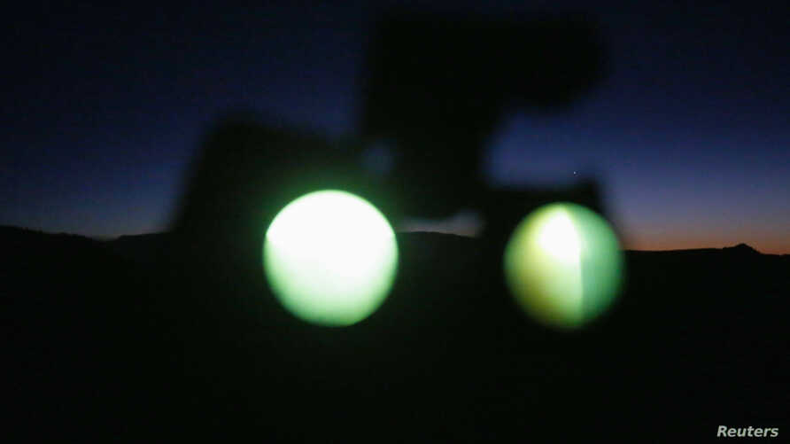 A pair of night vision goggles are seen being used in the desert outside Sedona, Arizona, Feb. 14, 2013. U.S. military night vision and thermal imaging scopes were among high-tech items Chinese national Kan Chen smuggled or tried to smuggle into Chin