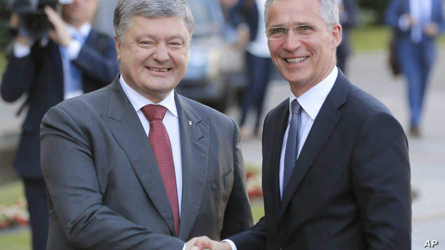 FILE - Ukrainian President Petro Poroshenko, left, and NATO Secretary General Jens Stoltenberg shake hands during a meeting in Kyiv, Ukraine, July. 10, 2017.