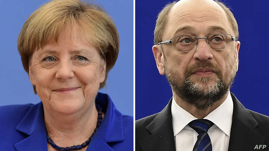 This combination of file pictures shows German Chancellor Angela Merkel (L), and the German Social Democratic SPD party's candidate for chancellorship Martin Schulz.
