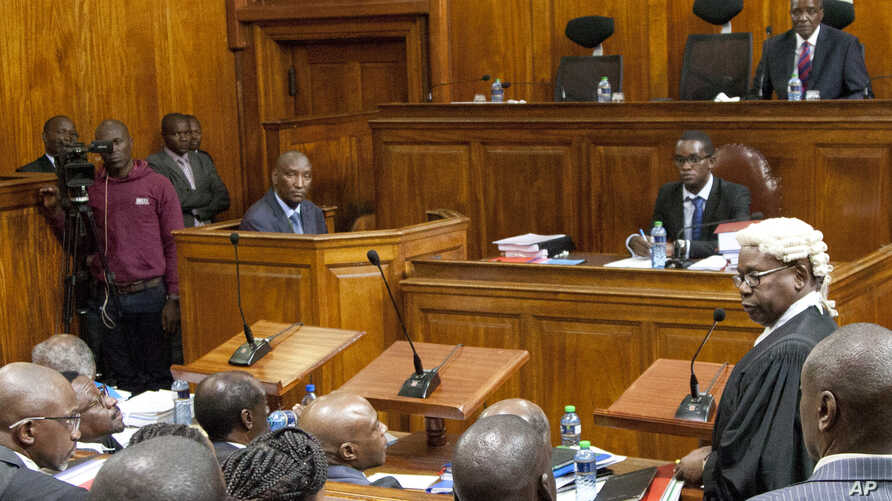 Kenyan Attorney General, Githu Muigai, right, addresses the court as David Maraga, Chief Justice of Kenya at Supreme Court, sat on Judges chair, listens, Oct. 25, 2017.