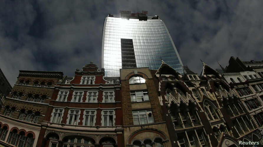 Sunlight is reflected from the Walkie Talkie tower in central London, Sept. 3, 2013.
