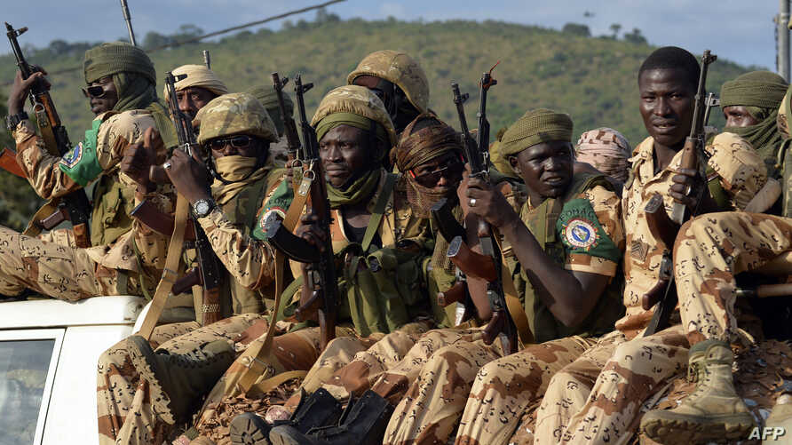 FILE - Chadian soldiers sit on a pickup truck as they leave Bangui on April 4, 2014, escorted by African-led International Support Mission to the Central African Republic (MISCA) forces (not pictured).