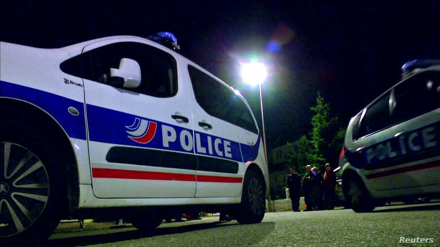 Still image taken from video shows Police vehicles at the scene near where a French police commander was stabbed to death in front of his home in the Paris suburb of Magnanville, France, June 14, 2016.