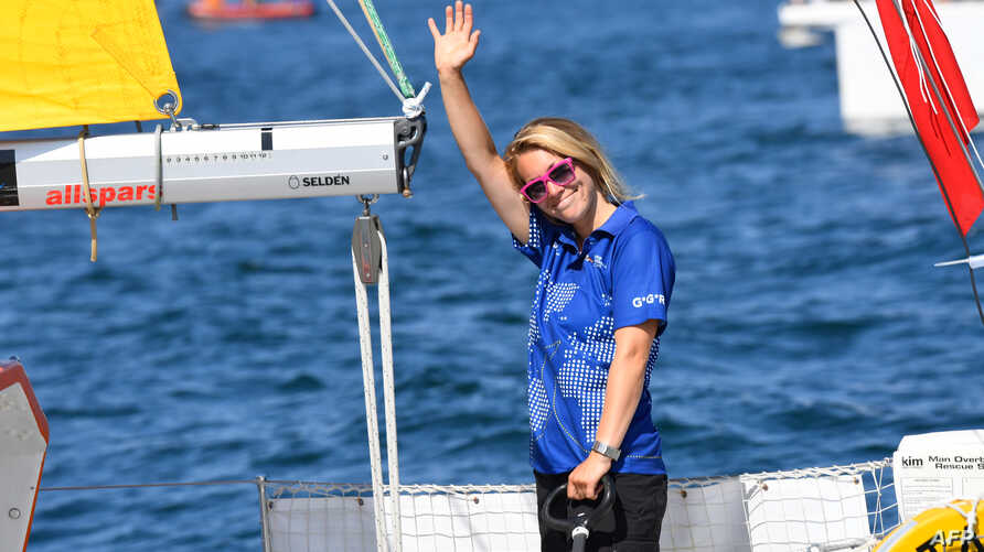 "FILE - British skipper Susie Goodall waves from the helm of her boat ""DHL Starlight"" as she leaves Les Sables d'Olonne Harbor, July 1, 2018, at the start of the solo around-the-world ""Golden Globe Race"" ocean race in which sailors compete without tec"