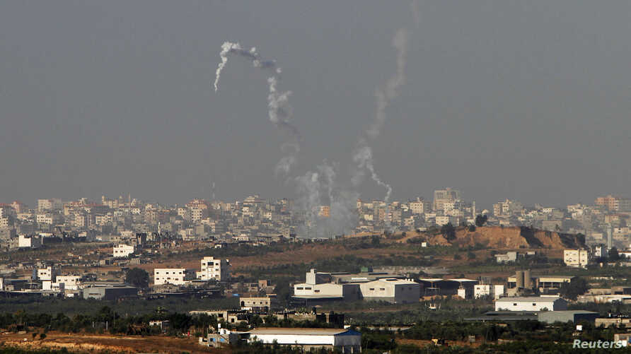 Trails of smoke are seen after the launch of rockets from the northern Gaza strip towards Israel, November 11, 2012.