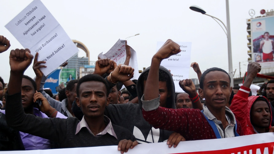 FILE - Protesters chant slogans during a demonstration over what they say is unfair distribution of wealth in the country at Meskel Square in Ethiopia's capital, Addis Ababa, Aug. 6, 2016.