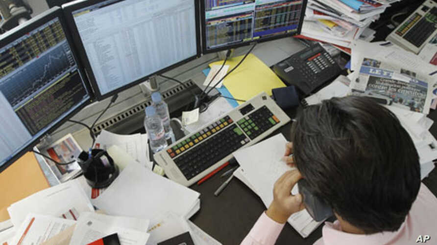 A broker speaks on the phone in a trading room in Paris, August 11, 2011