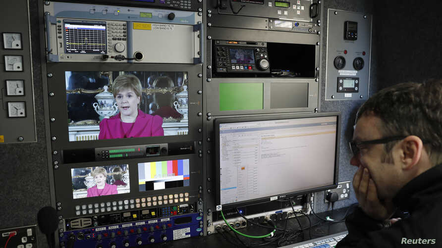 An engineer works in a television production truck as Scotland's First Minister Nicola Sturgeon demands a new independence referendum to be held in late 2018 or early 2019, once the terms of Britain's exit from the EU have become clearer, outside But