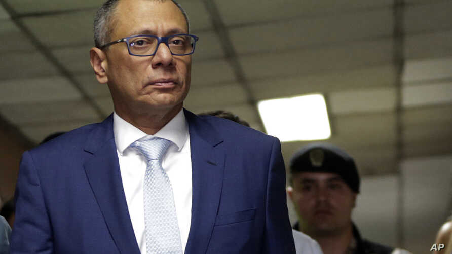 Ecuador's jailed Vice President Jorge Glas is escorted back to the courtroom for the judge's decision regarding his lawyer's habeas corpus request at the National Court, the country's highest court, in Quito, Ecuador, Oct. 15, 2017.