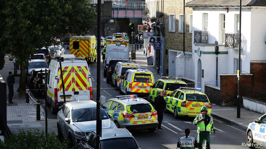 Police vehicles line the street near Parsons Green tube station in London, Britain, Sept. 15, 2017.