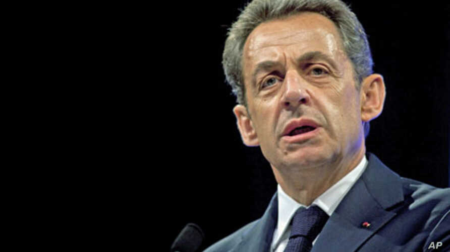 France's President and candidate for re-election in the 2012 election, Nicolas Sarkozy delivers a speech before building trade professionals as part of his campaign, in Paris, April 17, 2012.