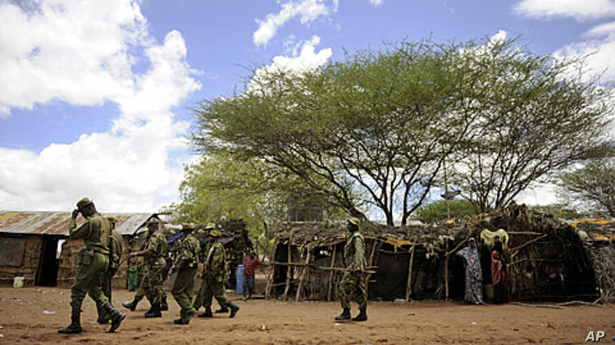 Kenyan security forces search at a village near near Liboi, Kenya's border town with Somalia, October 15, 2011.