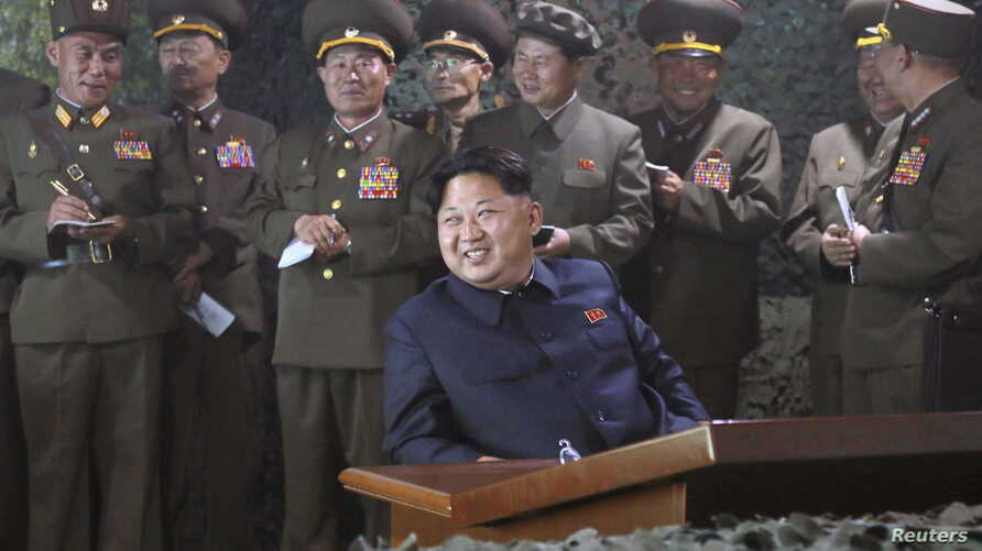 North Korean leader Kim Jong Un watches night naval fire strike drill of navy warship sub-unit and ground artillery sub-units in this undated photo released by North Korea's Korean Central News Agency (KCNA) on June 16, 2015.