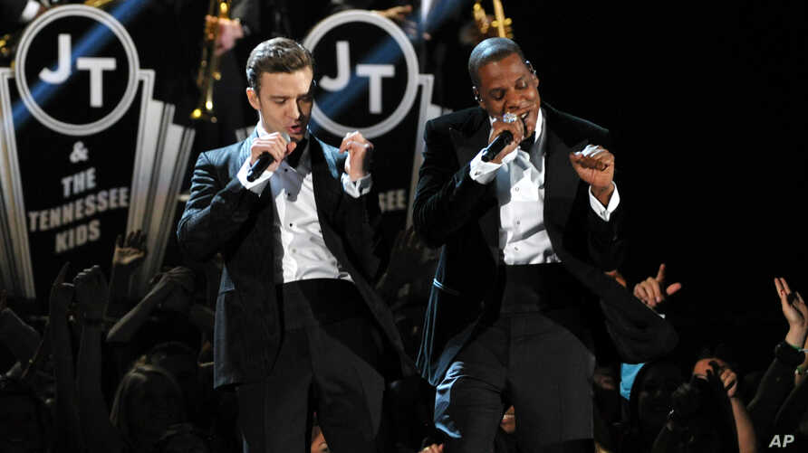 Justin Timberlake, left, and Jay-Z perform on stage at the 55th annual Grammy Awards on Feb. 10, 2013, in Los Angeles.