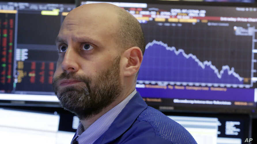 Specialist Meric Greenbaum works on the floor of the New York Stock Exchange, Feb. 2, 2018.