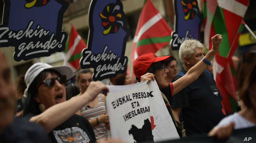 A demonstrator carries a flag calling for the return to Basque Country of the all prisoners of the Basque separatist armed group ETA while marching in the northern Spanish city of Bilbao, northern Spain, April 21, 2018, to demand that imprisoned memb