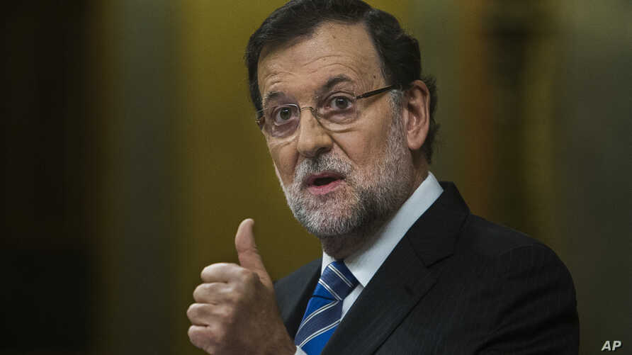 Spain's Prime Minister Mariano Rajoy gestures during a state of the nation debate at the Spanish Parliament in Madrid, Spain, Feb. 24, 2015.
