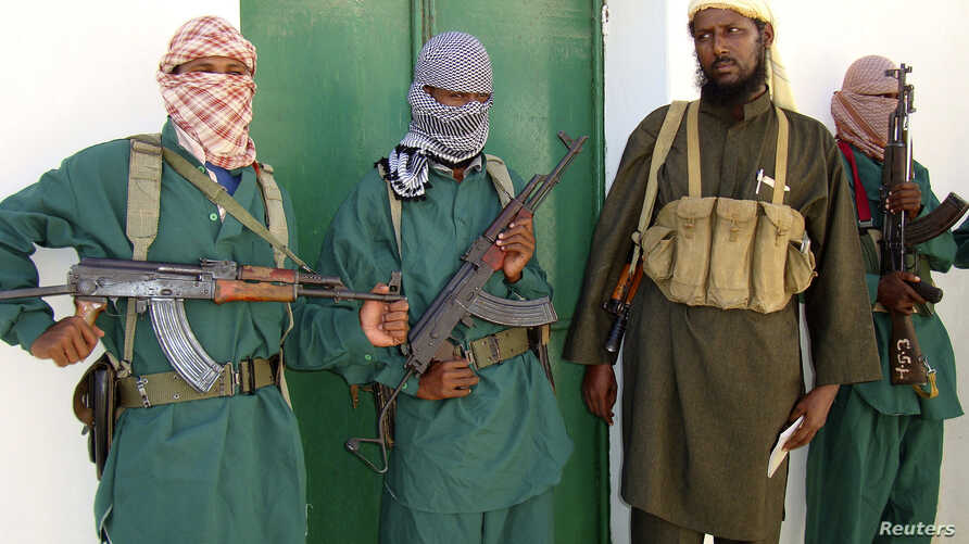 Sheik Muktar Robow Abu Mansur (2nd R), spokesman of Somalia's Islamic al-Shabab, leaves a news conference after vowing to step up attacks against government soldiers and foreign troops in Mogadishu December 14, 2008.  Somalia's President Abdullahi Yu