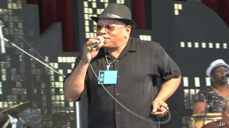 The Funk Brothers band, a famous R&B group from the 1960s, performs at the Smithsonian Folklife Festival.