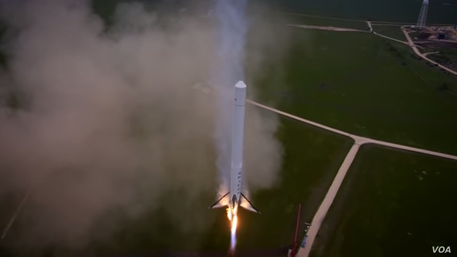 The Falcon 9 Reusable descends slowly back to the launch pad in a still from a video released by SpaceX.