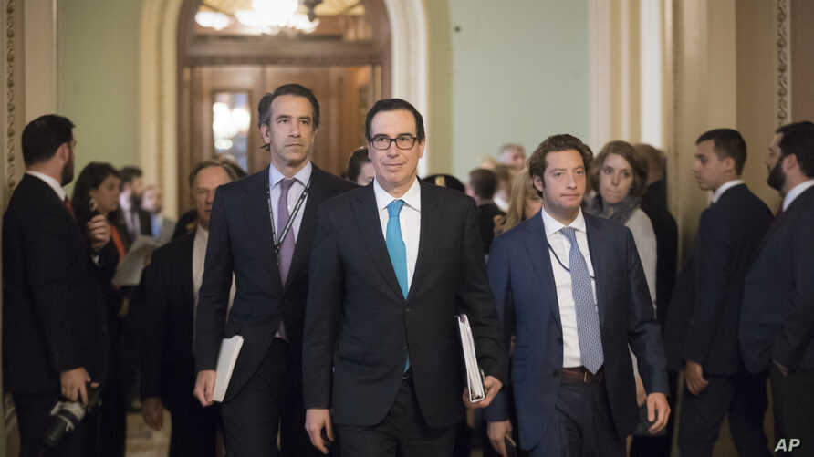 Treasury Secretary Steven Mnuchin arrives at the Capitol for a closed-door meeting with Senate Majority Leader Mitch McConnell, R-Ky, as they struggle to get a tax code overhaul, in Washington, Sept. 12, 2017.