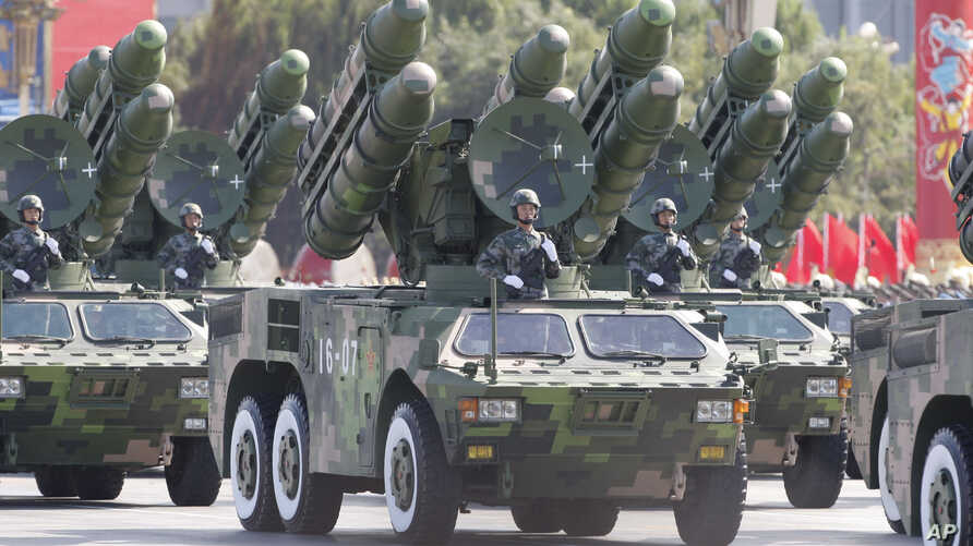 China's missiles are carried through Beijing's Tiananmen Gate during a military parade marking China's 60th anniversary in Beijing, China.