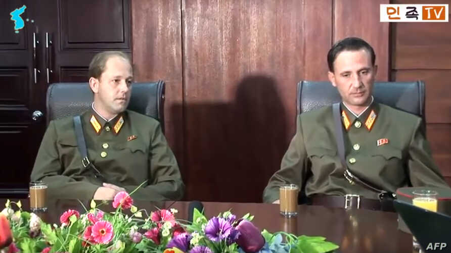 FILE - This screen grab taken Aug. 21, 2017, from an undated YouTube video released by Uriminzokkiri shows Ted Dresnok, right, son of US defector to North Korea James Joseph Dresnok, and his brother, James, during an interview at an unknown location.
