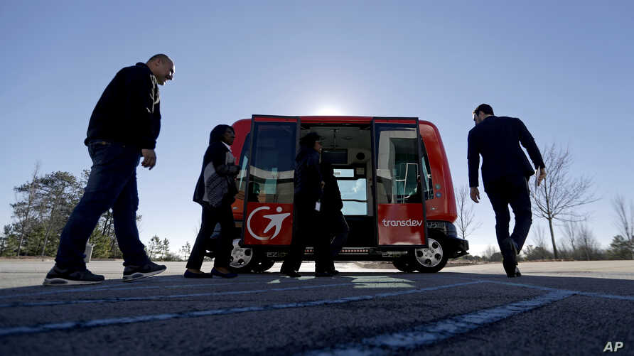 FILE - In this Thursday, Jan. 26, 2017 photo, a driverless shuttle sits on display at the Riverside EpiCenter in Austell, Ga.