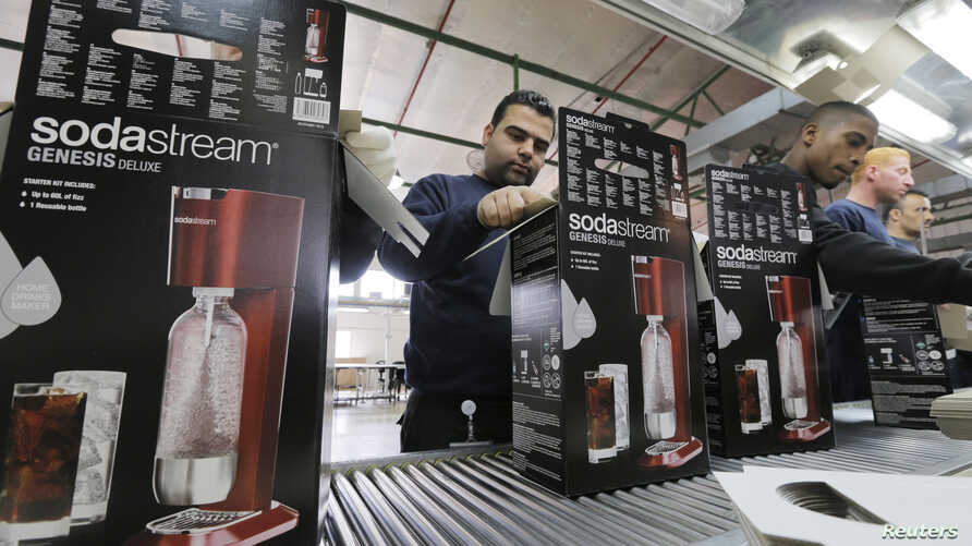 Employees pack boxes of SodaStream appliances at its factory in the West Bank Jewish settlement of Maale Adumim Jan. 28, 2014.