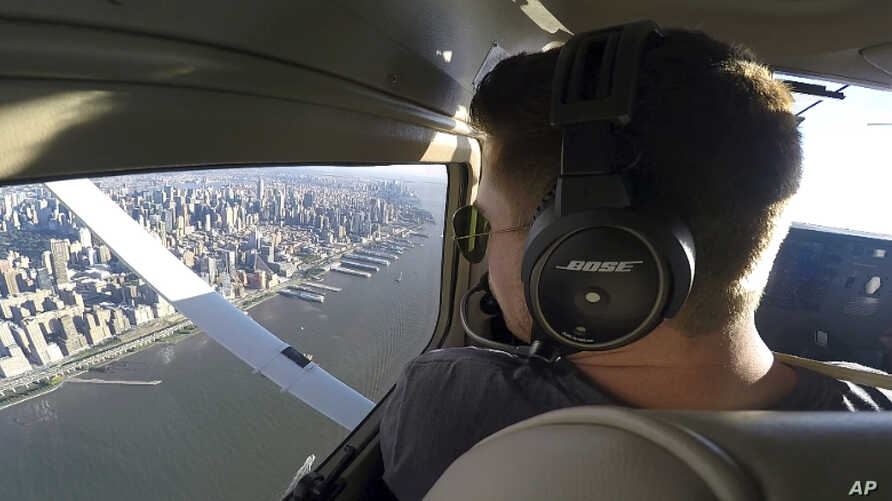 FILE -  In this image made from a video Aaron Ludomirski, certified flight instructor for Infinity Flight Group, flies over the Hudson River in New York, Aug. 23, 2017. Major U.S. airlines are hiring pilots at a rate not seen since before 9/11, and t