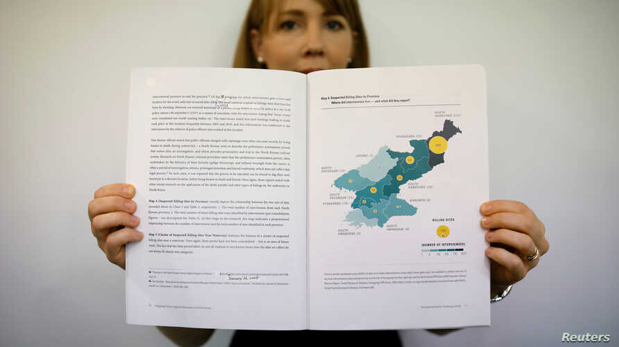 Sarah Son, research director of Transitional Justice Working Group, holds a graphic showing suspected killing sites in North Korea during an interview in Seoul, South Korea, July 19, 2017.