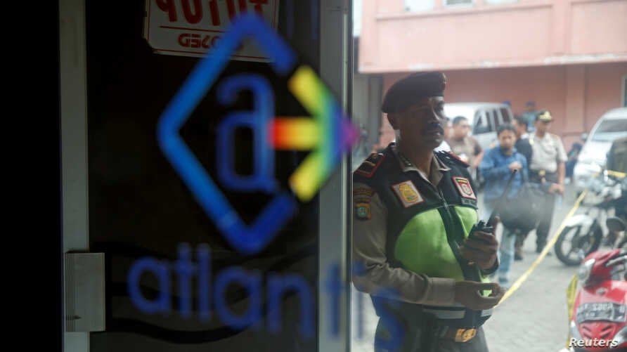 A policeman is seen outside the club where police detained 141 men for what they described as a gay prostitution ring, in Jakarta, Indonesia May 23, 2017.