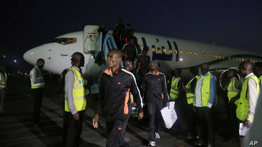 Nigerian returnees from Libya disembark from a plane upon arrival at the Murtala Muhammed International Airport in Lagos, Dec. 5, 2017.