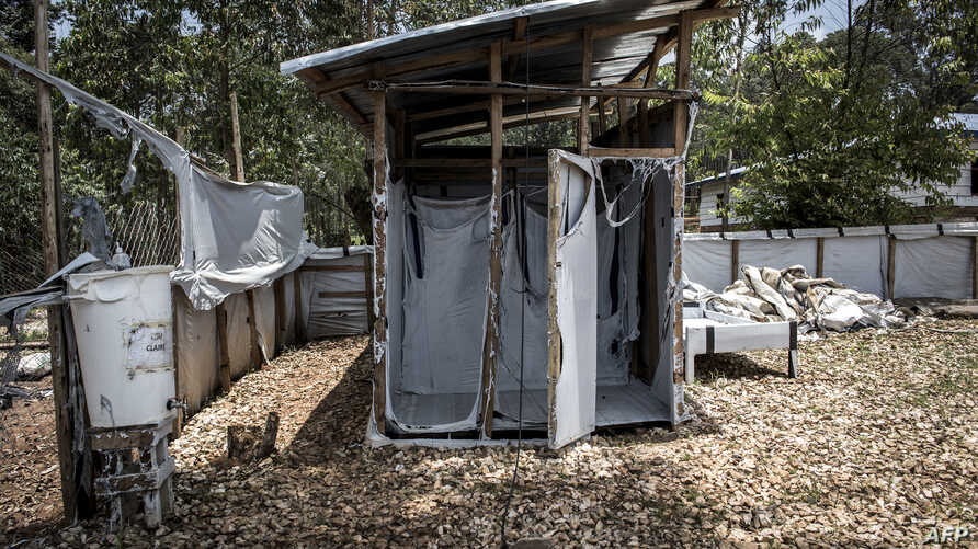 A picture taken in the early hours on March 9, 2019 in Butembo, shows burned equipment inside an Ebola treatment center which was attacked in the eastern part of the Democratic Republic of Congo.