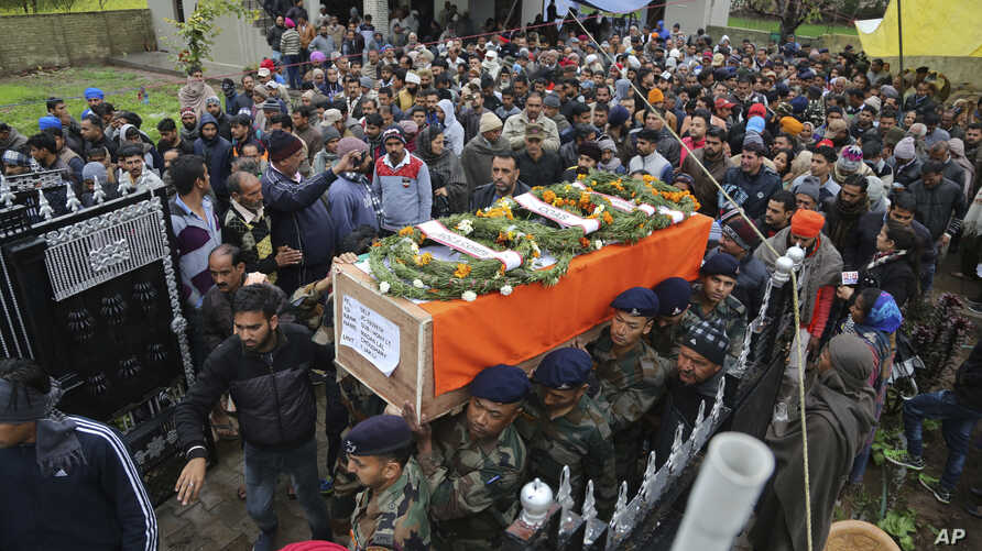 Indian army soldiers carry the body of their colleague Madan Lal Choudhary, who was killed in Saturday's militant attack on Indian army camp, during his funeral at village Bakrak, in Hiranagar, district Kathua, south of Jammu, India, Feb.12, 2018.