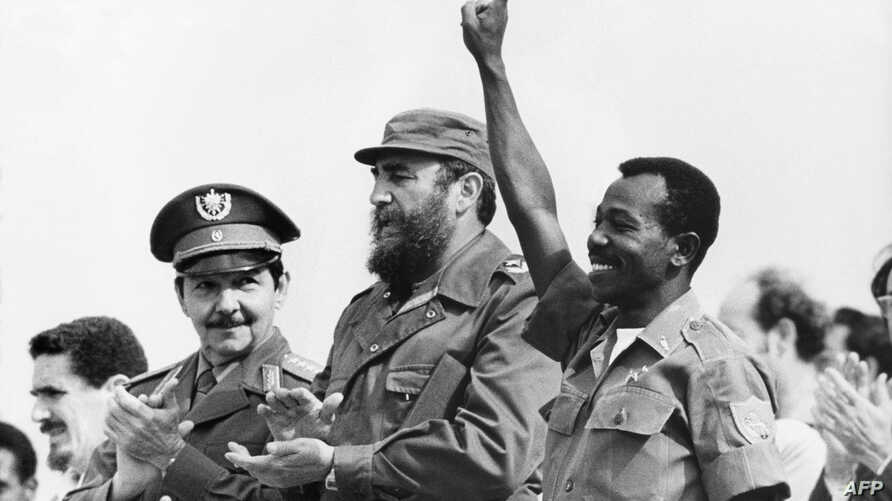 FILE - Ethiopian President Lieutenant Colonel Mengistu Haile Mariam (R) makes V sign as he stands with Fidel Castro (C) and Raul Castro (L) during an official visit in La Havana, Cuba, 25 April 1975. Mengistu took part in the attempted coup against H