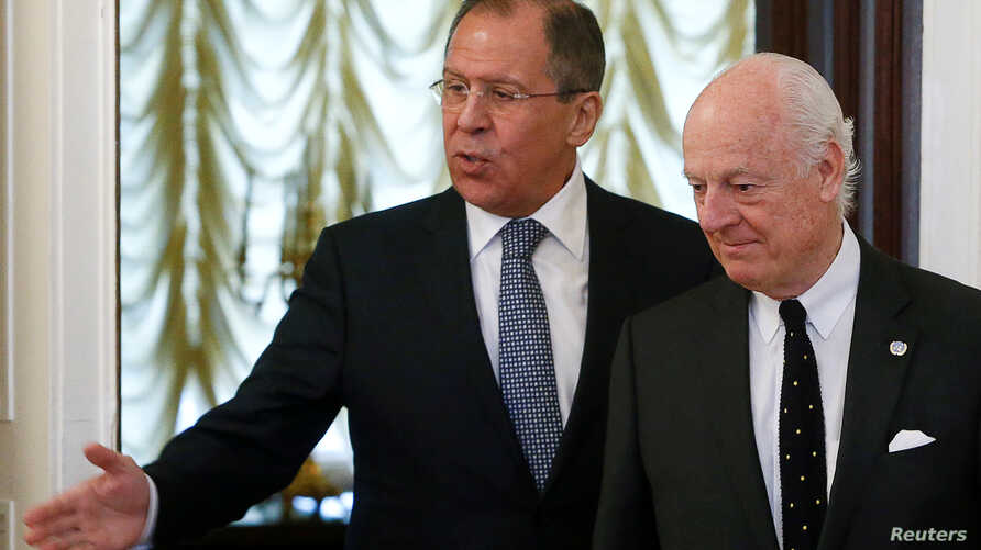 Russian Foreign Minister Sergei Lavrov (L) shows the way to United Nations special envoy on Syria Staffan de Mistura during a meeting in Moscow, Russia, May 3, 2016.
