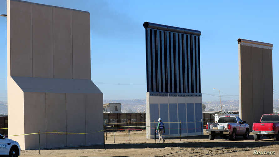 Three of U.S. President Donald Trump's eight border wall prototypes are shown near completion along U.S.- Mexico border in San Diego, California, Oct. 23,  2017.