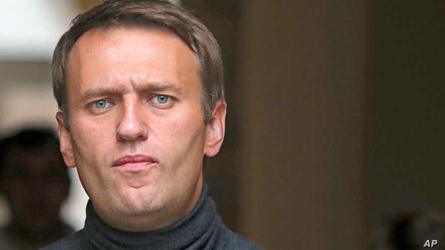 Russian opposition leader Alexei Navalny speaks to the media gathered outside his headquarters in Moscow,  Sept. 9, 2013.